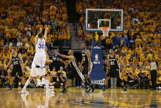 Steph splashing on the Spurs during Game Four [ (Photo by Jed Jacobsohn/Getty Images)]