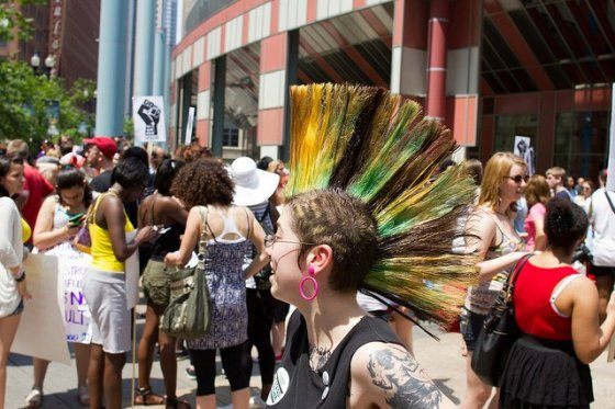 Rocking the Mohawk during a demonstration against sexual assault.