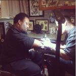 Tattoo being done on brown skin
